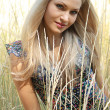 Sexual blonde girl near wheat — Stock Photo