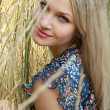 Sexual blonde girl near wheat — Stockfoto