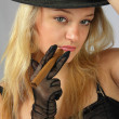 Blonde in hat with cigar — Stock Photo