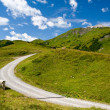 Alpine landscape and mountain road — Stock Photo