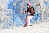 Girl skiing fast — Stock Photo