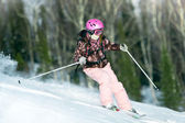 Girl riding on skis — Stock Photo