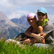 Foto Stock: Couple in mountains looking at camera