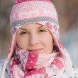 Pretty girl wearing warm hat and scarf — Stock Photo
