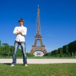 Young man standing on the Champs de Mars — Stock Photo