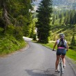 Girl riding fast on bicycle. Motion blur — Stock Photo