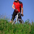 Young man with bicycle — Stock Photo