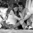 Happy young couple in park. B/W photo — Stock Photo