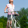 Royalty-Free Stock Photo: Cyclist girl enjoing the sun
