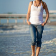 Young girl walking on a beach — Stock Photo #1107251