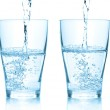 Water pouring into glasses. Set of diffe — Stock Photo