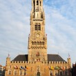 Central square and tower in Brugge — Stock Photo