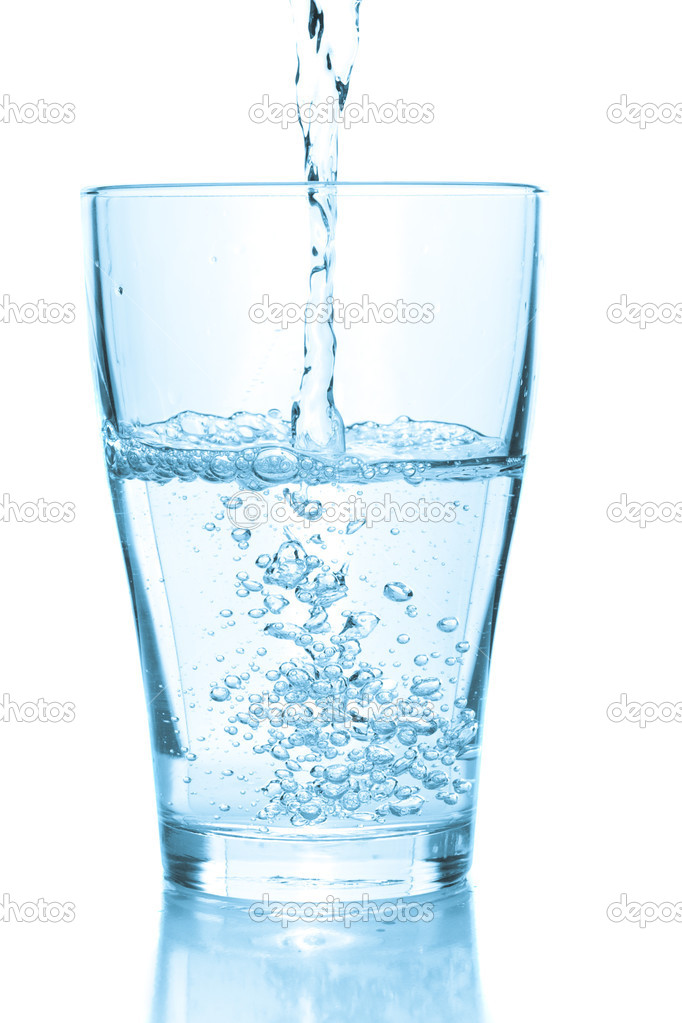Water pouring into glass. White background  Foto de Stock   #1152384