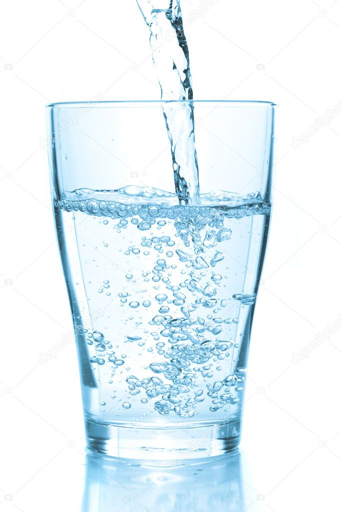 Water pouring into glass. White background — Stock Photo #1152389