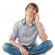 Young man looking dreamy with mobile pho — Stock Photo