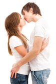 Tender kiss of young couple — Stock Photo