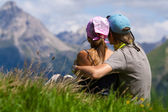 Couple enjoying a mountains view — Stock Photo