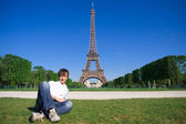 Young man lying on the Champs de Mars — Stock Photo