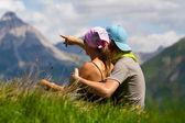 Couple enjoing a mountains view — Stock Photo