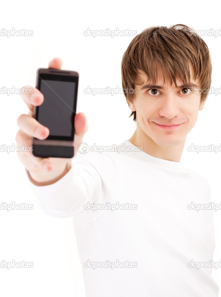 Young man showing mobile phone. Focus on the face — Zdjęcie stockowe #1702384