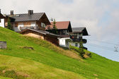 Alpine chalets on hill. Summer time — Stock Photo