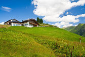 Alpine chalet in mountains. Summer time — Stok fotoğraf