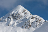 Snow covered mountain peak — Stock Photo