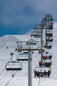 Ascend on chairlift — Stock Photo