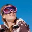 Skier looking up and smiling — Stock Photo