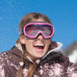 Happy girl on winter vacation — Stock Photo