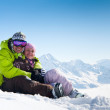 Young happy couple in winter mountains — Stock Photo