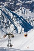 Gondola lift on high mountain ski resort — Stock Photo