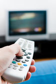 Hand with remote TV control — Stock Photo