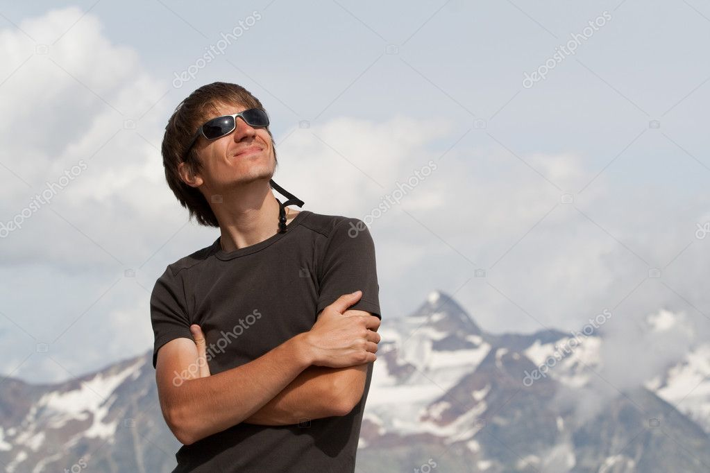 Young man enjoying the sun high in the mountains — Stock Photo #2601340