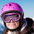 Girl in ski helmet smiling — Stock Photo