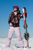 Girl skier with skis — Stock Photo