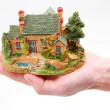 A small house in hands — Stock Photo