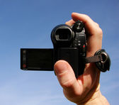 Video camera is in a hand — Stock Photo