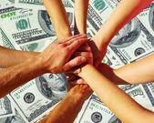 Hands on dollars — Stock Photo