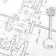 Key on a house blueprints — Stok fotoğraf