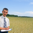 Man inspecting the wheat — Stock Photo #1080278