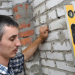 Man checking the level of a wall — Stock Photo