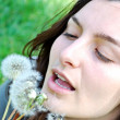 Royalty-Free Stock Photo: Girl is blowing on dandelion