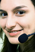 Face of smiling woman in headphones — Stock Photo
