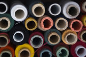 Many-coloured bobbins of thread — Stockfoto