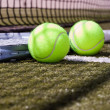 Tennis balls and racquet — Stock Photo