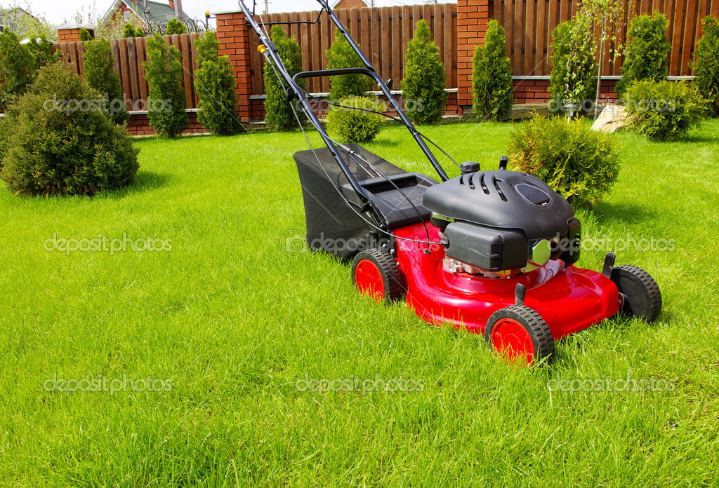 Lawn mower in the garden  Stock Photo #1076743