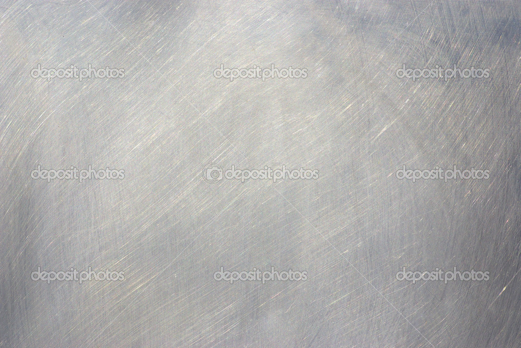 Brushed Metal texture with lighting and lens ghost.  — Stock Photo #1079091