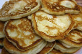 A lot of hot fritters it is prepared for a breakfast, to tea. They tasty. — Stock Photo