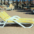Stock Photo: Deck chairs on beach